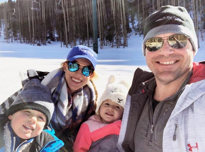 family on the ski slopes in Santa Fe, New Mexico