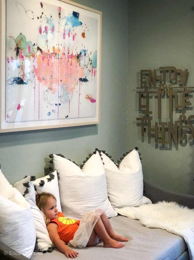 closer look at art and bedding in playroom